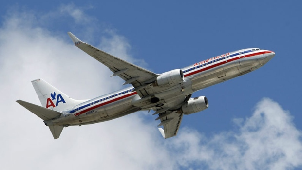 An American Airlines passenger jet takes off at Miami International Airport in Miami, Wednesday, April 20, 2011. (AP Photo/Alan Diaz)