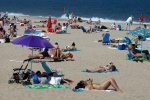 People sit in the sun at Point Pleasant Beach, N.J. in this 2011 file photo. (AP Photo/Mel Evans)