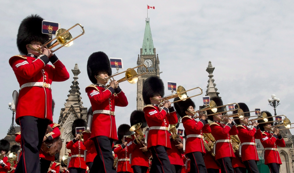 The Ceremonial Guard band plays as the daily Changing of the Guard parade leaves Parliament Hill Tuesday June 25, 2013 in Ottawa. (Adrian Wyld / THE CANADIAN PRESS)