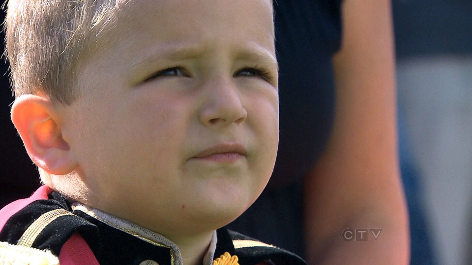 Isaac De Franco, 4, marches with the Ceremonial Guardsmen and regimental band on Parliament Hill in Ottawa.