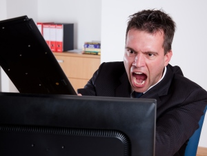 More than a third of U.S. consumers with computer problems admit to threatening their devices with violence, according to a recent stud. (Peter Bernik / Shutterstock.com)