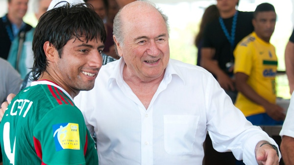 In this photo provided by ACT Productions, FIFA president Sepp Blatter, right, meets Francisco Cati from the Mexican national beach soccer team during the CONCACAF congress in Miami on Monday, May 2, 2011. (AP Photo/ACT Productions, Mitchell Zachs)