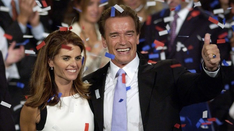 This file photo taken Oct. 7, 2003, shows Arnold Schwarzenegger and his wife, Maria Shriver ,as they celebrate his victory in the California gubernatorial recall election in Los Angeles. (AP Photo/Mark J. Terrill, File)