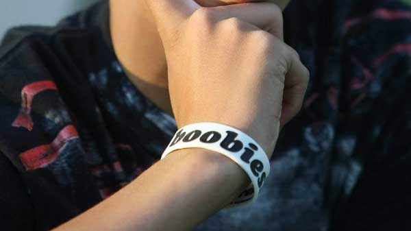 "A student wears a ""I (heart) boobies"" bracelet, which is meant to raise breast cancer awareness. (THE ASSOCIATED PRESS / Laramie Boomerang, Andy Carpenean)"