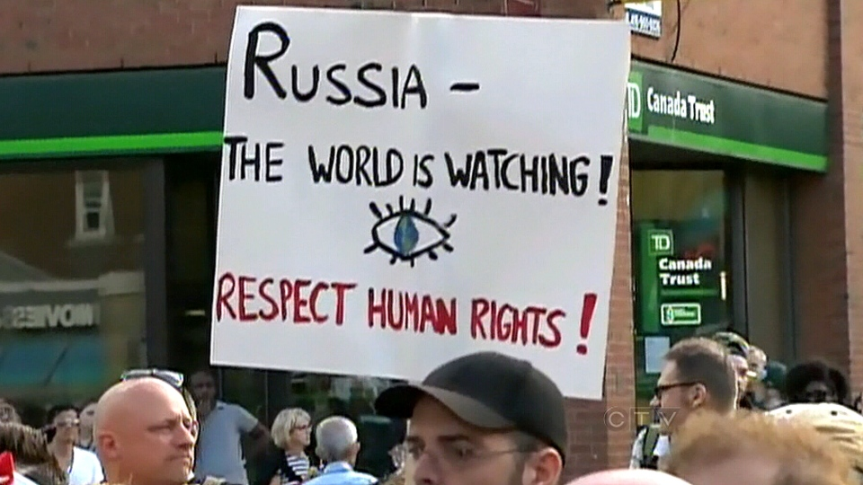 Protesters gather in response to Russia's new anti-gay laws, in Toronto, Saturday, Aug. 3, 2013.