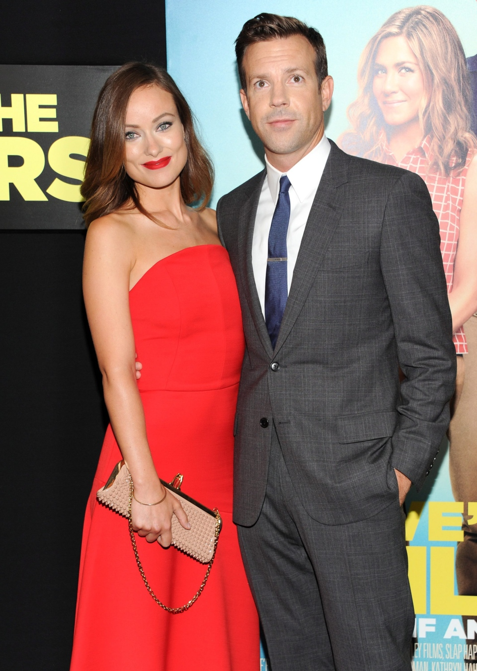 Actor Jason Sudeikis, right, and his fiancee Olivia Wilde attend the world premiere of 'We're the Millers' at the Ziegfeld Theatre in New York on Thursday, Aug. 1, 2013. (Evan Agostini/Invision)