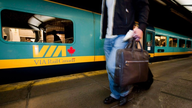Passengers board a train to Toronto in Montreal, on July 26, 2009. (Peter McCabe / THE CANADIAN PRESS)