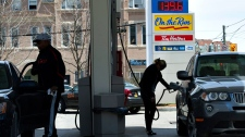 A woman pumps gas in Toronto on Tuesday, May 10, 2011. (Nathan Denette / THE CANADIAN PRESS)