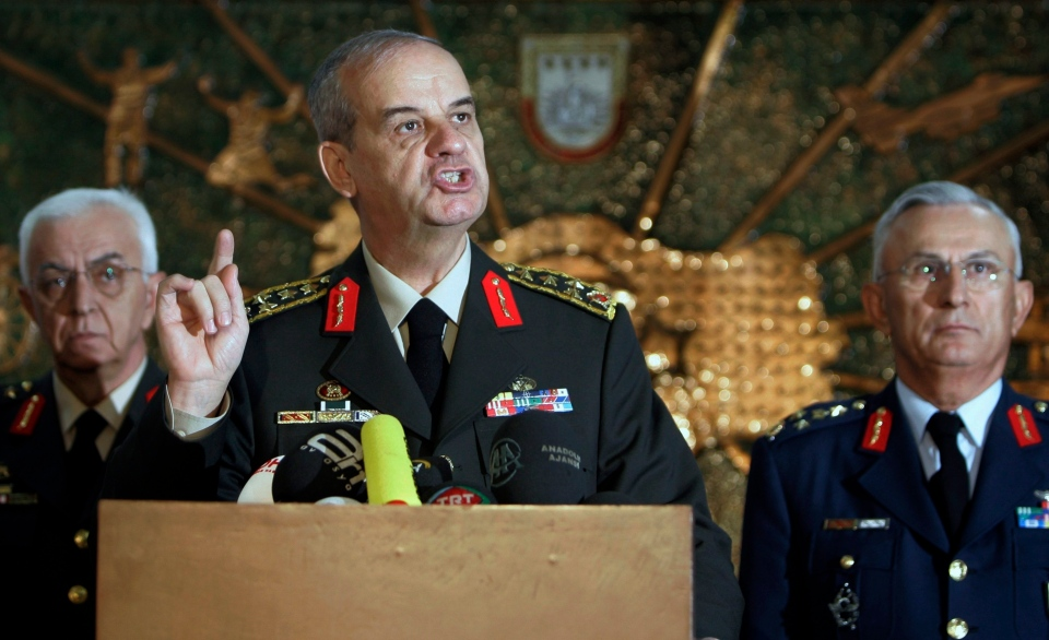 In this Oct. 15, 2008 file photo, flanked by former Land Forces Commander Gen. Isik Kosaner, left, and former Air Forces Commander Gen. Aydogan Babaoglu, right, Turkey's former Chief of Staff Gen. Ilker Basbug speaks to the media during a military ceremony in Balikesir, Turkey.  (AP Photo/Burhan Ozbilici, File)