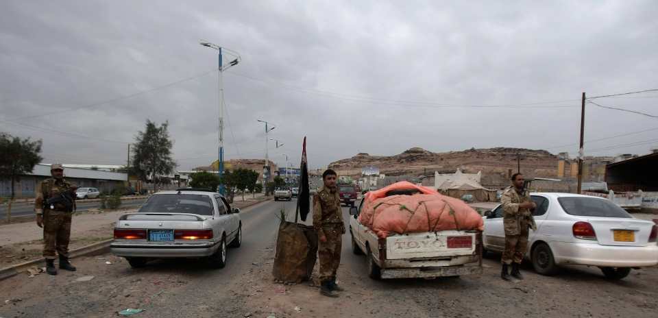 Yemeni soldiers inspect cars at a checkpoint on a road leading to the U.S. embassy in Sanaa, Yemen, Sunday, Aug. 4, 2013.(AP Photo/Hani Mohammed)