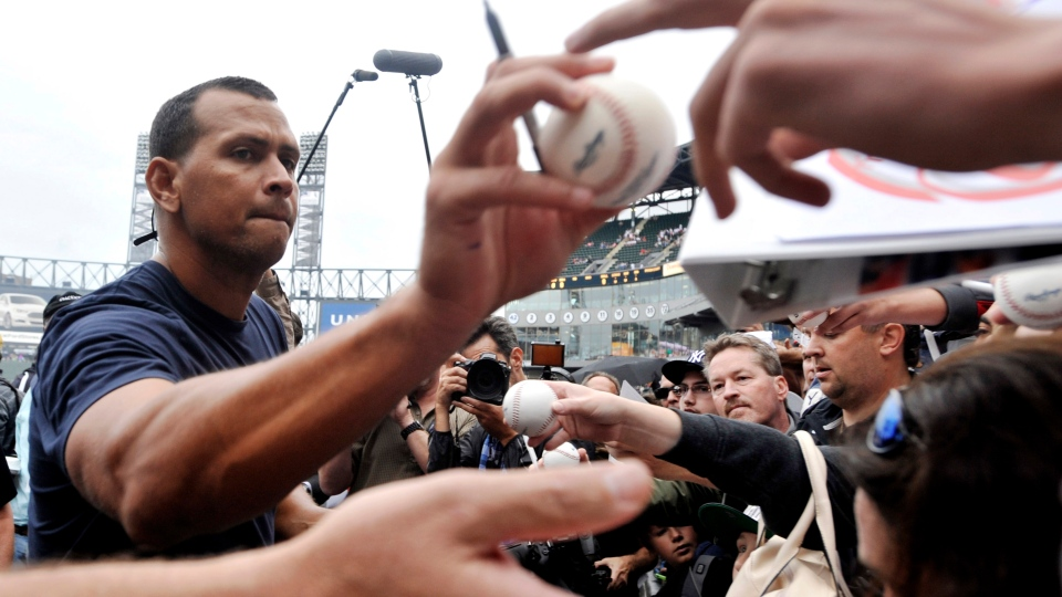 New York Yankees' Alex Rodriguez, left, signs autographs at U.S. Cellular Field before a baseball game against the Chicago White Sox in Chicago, Monday, Aug. 5, 2013. (AP / Paul Beaty)
