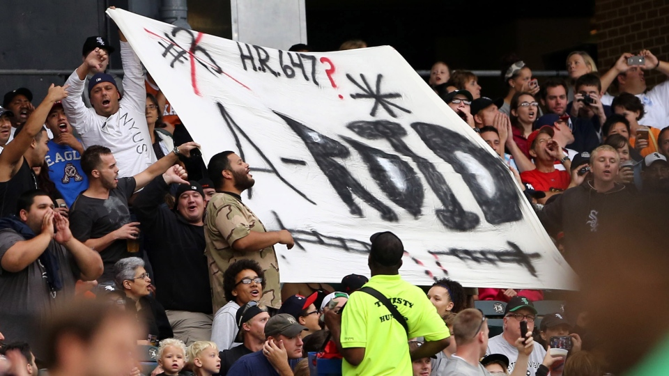 Chicago White Sox fans hold up a sign as Alex Rodriguez bats for the first time in a baseball game at US Cellular Field in Chicago on Monday, Aug.,5, 2013. (AP / Charles Cherney)