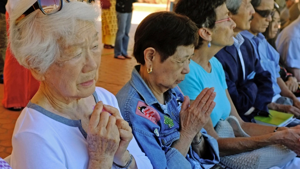 Kiyome Hirayama, 90, whose husband was a Japanese solder in Hiroshima, Japan, left, prays at a Buddhist ceremony for peace at Japanese American Cultural & Community Center (JACCC) in Los Angeles Monday, Aug. 5, 2013. (AP / Nick Ut)