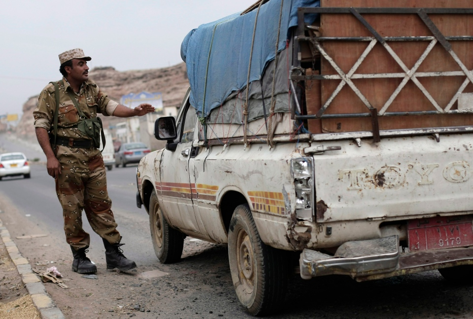 A Yemeni soldier stops a car at a checkpoint in a street leading to the U.S. embassy in Sanaa, Yemen on Aug. 4, 2013. (AP / Hani Mohammed)