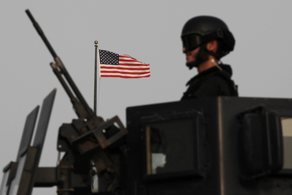 A Bahraini armoured personnel vehicle reinforces U.S. Embassy security just outside a gate to the embassy building in Manama, Bahrain, on Sunday, Aug. 4, 2013. (AP / Hasan Jamali)