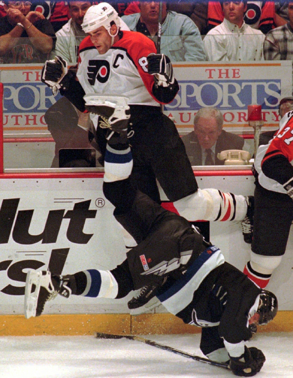 Philadelphia Flyers Eric Lindros, top centre, and Tampa Bay Lightning Shawn Burr are topsy-turvy against the boards in the first period of Game 5 of the Stanley Cup playoff round in Philadelphia on Thursday, April 26, 1996. (AP / Rusty Kennedy)