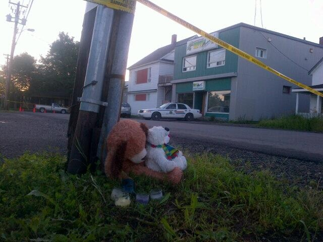 A memorial is set up outside Reptile Ocean Inc. in Campbellton, N.B. after two brothers were strangled to death by a giant python who had escaped its enclosure. (Todd Battis / CTV News)