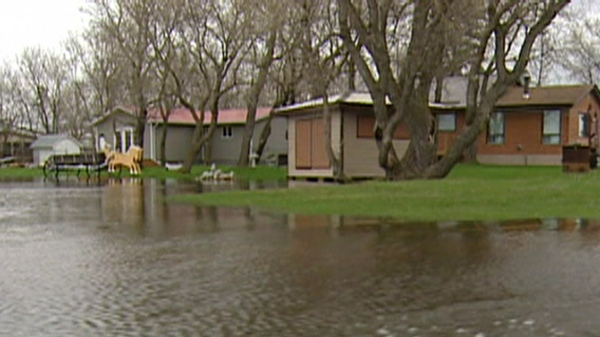 Some residents in Portage la Prairie, Man. were evacuated at a moment's notice after officials announced they would conduct a controlled breach on a dike along the Assiniboine River, Wednesday, May 11, 2011.