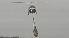 Helicopters are being used in some cases to transport sandbags.