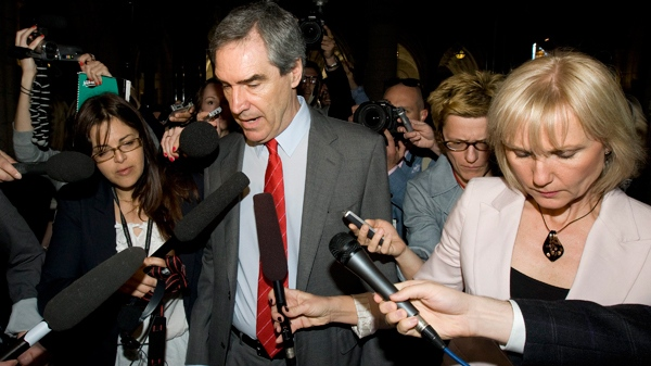 Outgoing Liberal leader Michael Ignatieff is questioned by reporters as he arrives for his first caucus meetings following the federal election in Ottawa, Wednesday May 11, 2011. (Adrian Wyld / THE CANADIAN PRESS)