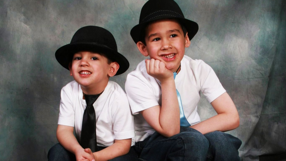 Noah Barthe, left, and Connor Barthe pose in this undated photo. Police say Noah and Connor Barthe were found dead Monday morning after an African rock python escaped its enclosure in an apartment, slithered through a ventilation system above and fell through a ceiling into the living room where they slept. (Facebook)