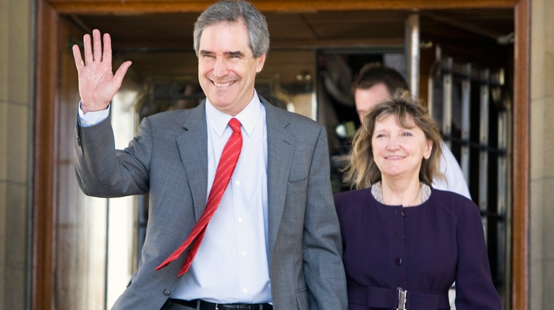 Outgoing Liberal Leader Michael Ignatieff waves as he leaves Parliament Hill with his wife Zsuzsanna Zsohar following a party caucus meeting in Ottawa, Wednesday, May 11, 2011. (Adrian Wyld / THE CANADIAN PRESS)