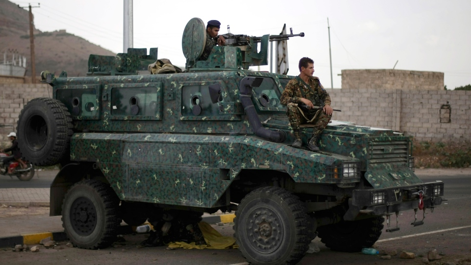 Police in an armored vehicle secure a road leading to the U.S. embassy in Sanaa, Yemen, Tuesday, Aug. 6, 2013. (AP / Hani Mohammed)