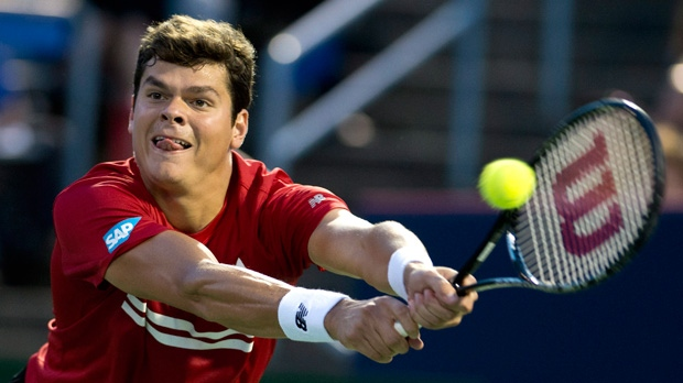 Canada's Milos Raonic returns to Jeremy Chardy from France during first round of play at the Rogers Cup tennis tournament Tuesday August 6, 2013 in Montreal. Raonic beat Chardy 6-3, 4-6, 7-5. THE CANADIAN PRESS/Paul Chiasson