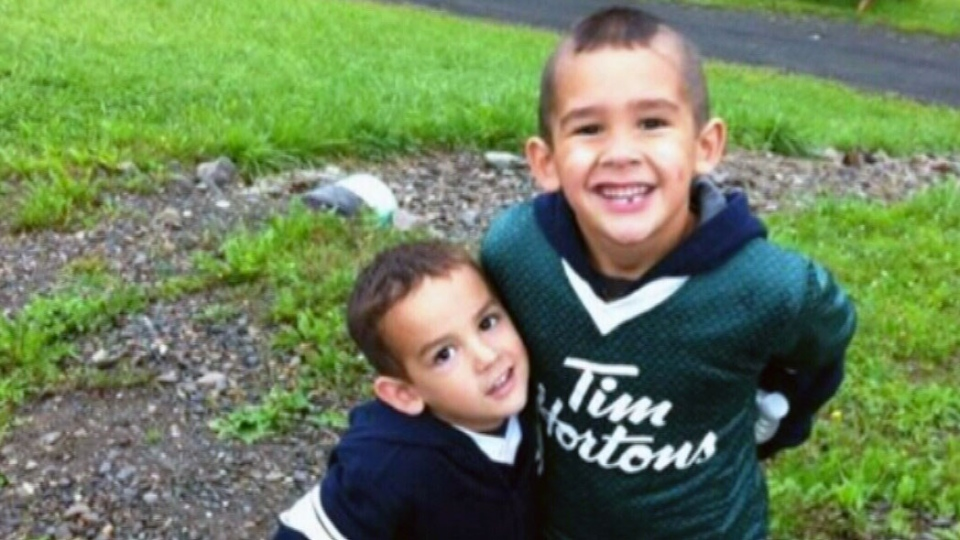 Two young boys sleeping at a friend's apartment are dead after they were strangled by a python that had escaped its enclosure in New Brunswick on Monday, Aug. 5, 2013.