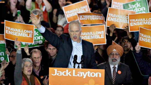 NDP Leader Jack Layton waves to his largest crowd yet in the province of Quebec in Montreal, Saturday, April 23, 2011. (Jacques Boissinot / THE CANADIAN PRESS)