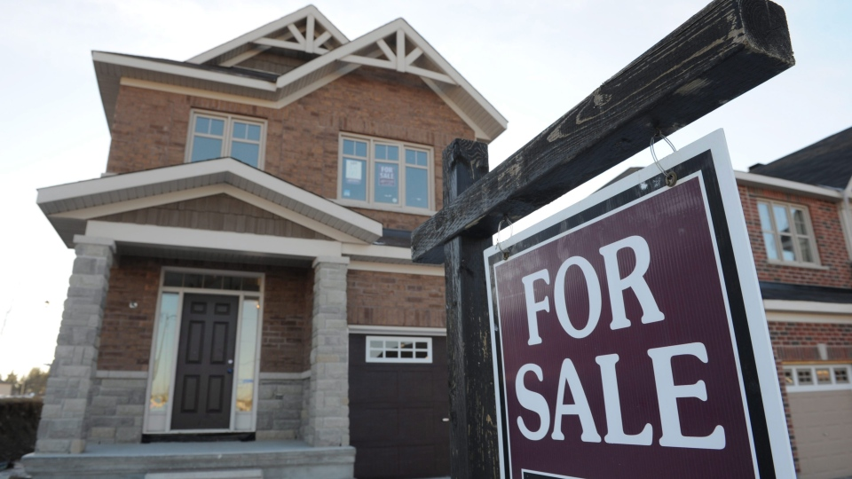 The Royal Bank of Canada says the ability of Canadians to keep up with housing costs has been improving of late, but warns that's about to change. (Sean Kilpatrick / THE CANADIAN PRESS)
