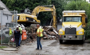 The house where three women were held captive and raped for more than a decade is demolished, in Cleveland, Wednesday, Aug. 7, 2013. (AP / Tony Dejak)
