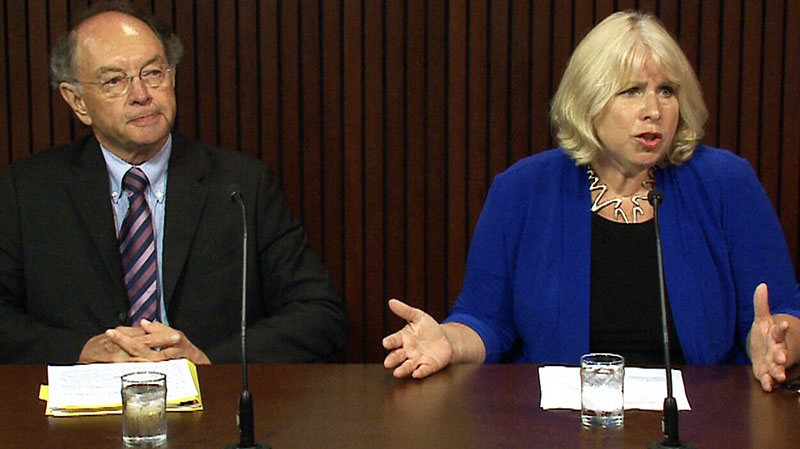 Jake Thiessen, who headed the review, left, and Liberal MPP Deb Matthews, right, discuss the review after four Ontario hospitals were given diluted chemo drugs on Wednesday, Aug. 7, 2013.