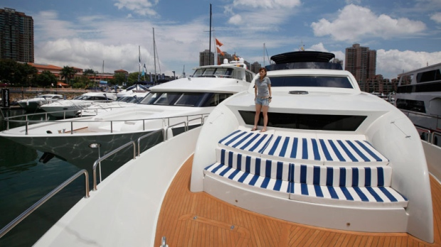 A staff member stands on the Chinese made yacht Accelera 98 at a boat show in Hong Kong, May 6, 2011. (AP / Kin Cheung)