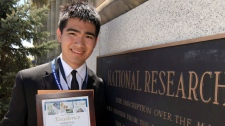 Marshall Zhang of Bayview Secondary school in Toronto, who won first prize at the National Research's 2011 Biotalent Challenge Awards, holds his award during a ceremony at the National Research Council headquarters in Ottawa, Tuesday May 10, 2011. (Fred Chartrand / THE CANADIAN PRESS)