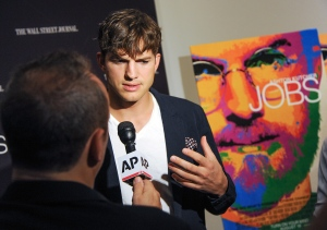 Actor Ashton Kutcher is interviewed as he attends a special screening of 'JOBS' hosted by The Wall Street Journal at the Museum of Modern Art on Wednesday, Aug. 7, 2013, in New York. (Evan Agostini/Invision)