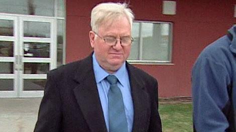 Accused killer Kim Walker is seen leaving court in Yorkton on Thursday.