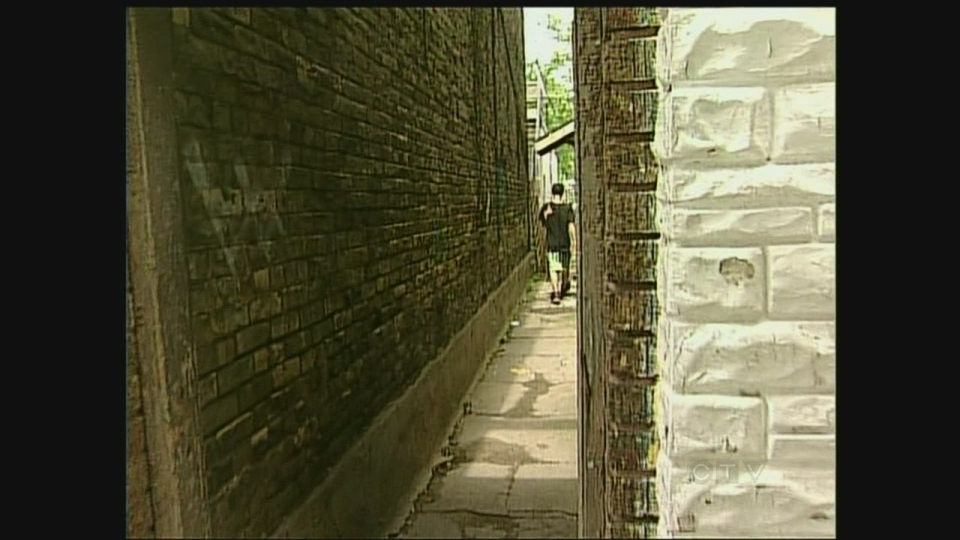An alleyway in east London, Ont. is a magnet for drugs and crime, seen Thursday, August 8, 2013.