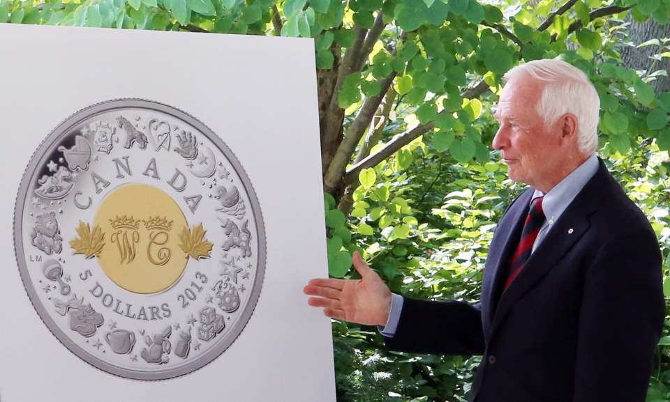 Governor General David Johnston takes part in the unveiling of the Royal Canadian Mint collector coins, celebrating the birth of Prince George of Cambridge, the newborn son of Prince William and his wife Catherine, during a ceremony at Rideau Hall in Ottawa Thursday, August 8, 2013. (THE CANADIAN PRESS/Fred Chartrand)