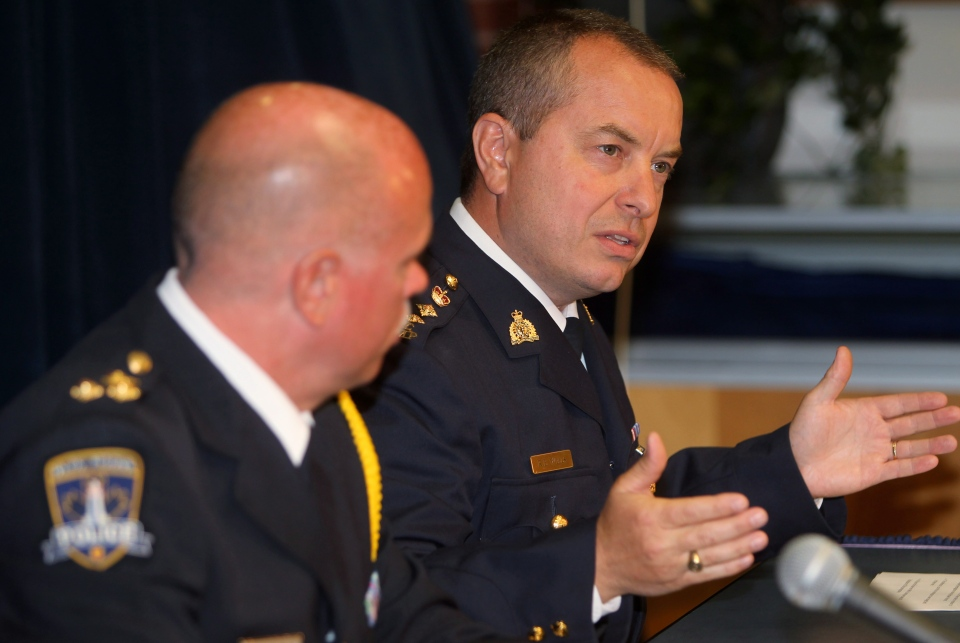 Halifax RCMP Chief Superintendent Roland Wells gestures while speaking as Halifax Regional Police Chief Jean-Michel Blais listens during a news conference in Halifax on Thursday, August 8, 2013. (Mike Dembeck / THE CANADIAN PRESS)