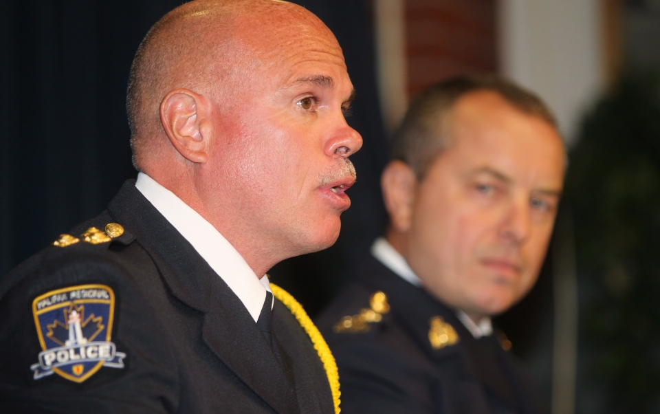 Halifax Regional Police Chief Jean-Michel Blais speaks as Halifax RCMP Chief Superintendent Roland Wells (right) listens during a news conference in Halifax on Thursday, August 8, 2013. (Mike Dembeck / THE CANADIAN PRESS)
