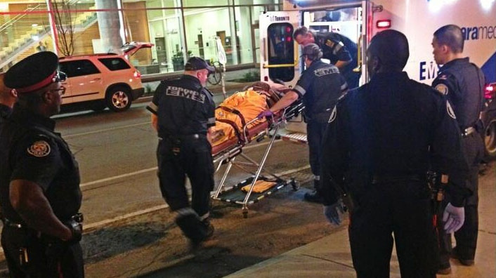Paramedics transport a man after a shooting on King Street West early Friday, Aug. 9, 2013. (Tom Podolec/CTV)