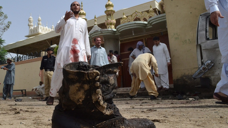 Pakistani investigators collect evidence at the site of a bomb attack in Quetta, Pakistan, Thursday, Aug. 8, 2013. (AP / Arshad Butt)