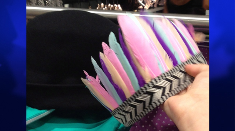 A faux feather headdress is shown on Wednesday, Aug. 7, 2013, in this handout photo. H&M stores across Canada. (THE CANADIAN PRESS / HO-Kim Wheeler)