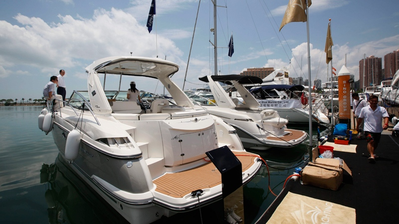 Chinese visitors tour on a yacht at a boat show in Hong Kong, May 6, 2011. (AP Photo/Kin Cheung)