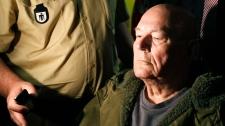 John Demjanjuk leaves the court room in Munich, southern Germany, Thursday, May 12, 2011. (AP / Matthias Schrader)