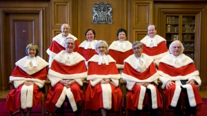 The Supreme Court Justices of Canada pose for a photograph pior to the public swearing of Justice Thomas Cromwell (back right) at the Supreme Court of Canada in Ottawa Monday Feb. 16, 2009. William Binnie is second from the left in the front row. Louise Charron is third from right in back row. (THE CANADIAN PRESS/Adrian Wyld)