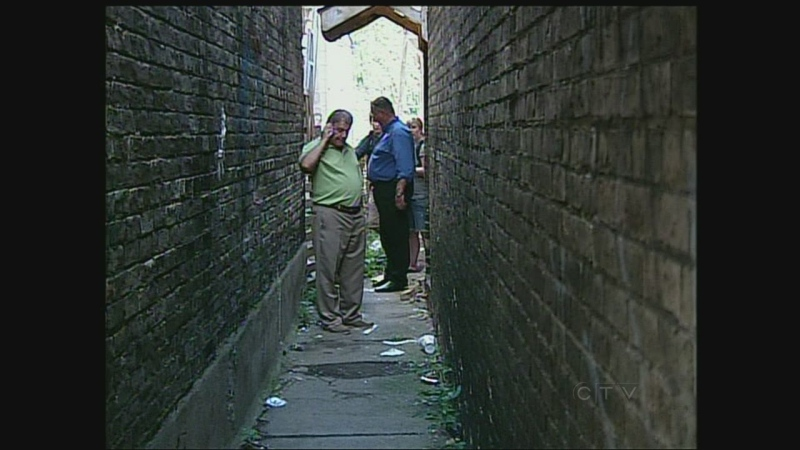 London Mayor Joe Fontana, left, tours an alleyway in east London, Ont. on Friday, August 9, 2013.