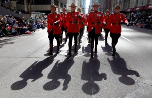 RCMP march during the Calgary Stampede parade on July 5, 2013. (Jeff McIntosh / The Canadian Press)