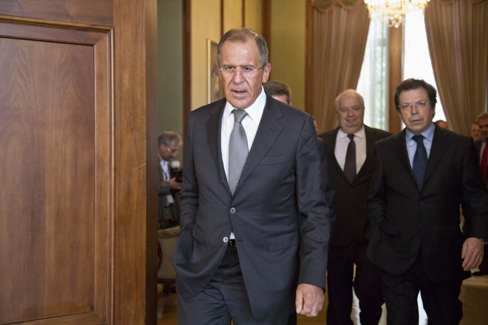Russian Foreign Minister Sergei Lavrov, center, leaves after a news conference at Russian Embassy in Washington, Friday, Aug. 9, 2013. (AP / J. Scott Applewhite)